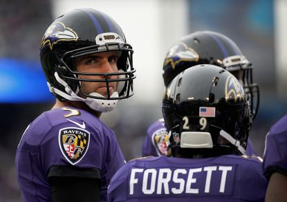Ravens quarterback Joe Flacco stands next to Justin Forsett during the first half against the St. Louis Rams at M&T Bank Stadium on Nov. 22, 2015 in Baltimore.