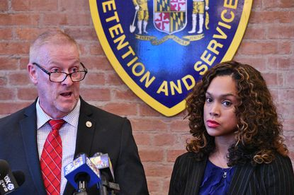 Robert Green, Secretary of the Department of Public Safety and Correctional Services, left, and City State's Attorney Marilyn Mosby announce the indictment of 25 correctional officers and staff, who were charged with excessive use of force on detainees at state-operated Baltimore pretrial correctional facilities.