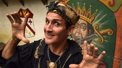 This Sept. 3, 2016 photo shows Johnny Fox performing at the Maryland Renaissance Festival, in Crownsville. The sword-swallowing magician who presented his quirky art form to enthusiastic audiences around the world has died at age 64.