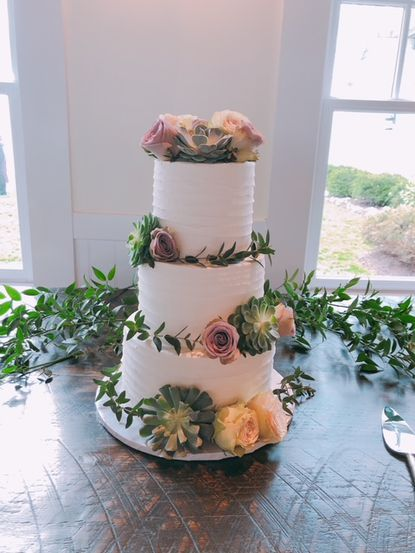 Roses and succulents decorate a cake made by Blue Crab Cupcakes in Annapolis.