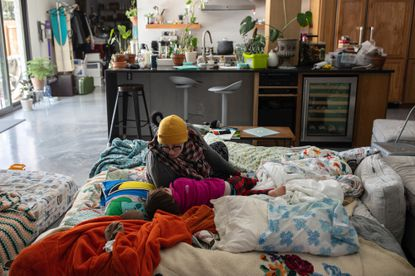 Greta Kreidner and her son Jasper, 3, lay on a mattress covered in blankets, Tuesday, Feb. 16, 2021, which her family placed next to their fireplace to stay warm after losing power early Monday morning, in Austin, Texas. Huge winter storms have plunged large parts of the central and southern United States into an energy crisis this week as frigid blasts of Arctic weather crippled electric grids and left millions of Americans without power amid dangerously cold temperatures. (Tamir Kalifa/The New York Time