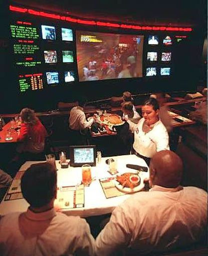 Patrons can eat in front of a wall of televisions at the ESPN Zone. The game room is upstairs.