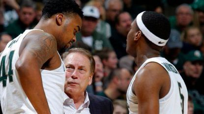 Michigan State coach Tom Izzo, center, talks with Nick Ward, left, and Cassius Winston during a game against Savannah State, Sunday in East Lansing, Mich. Maryland plays No. 1 Michigan State on Thursday.