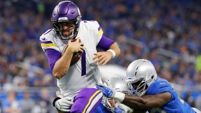 Vikings quarterback Case Keenum pulls away from the Lions defense to score on a 9-yard run during the first half on Thursday, Nov. 23, 2017, in Detroit.