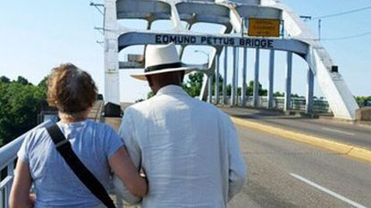 Carol and William Allen of Havre de Grace lead a group of teachers across the Edmund Pettus Bridge in Selma, Ala., in mid-July during a learning tour of Historic Civil Rights movement sites.