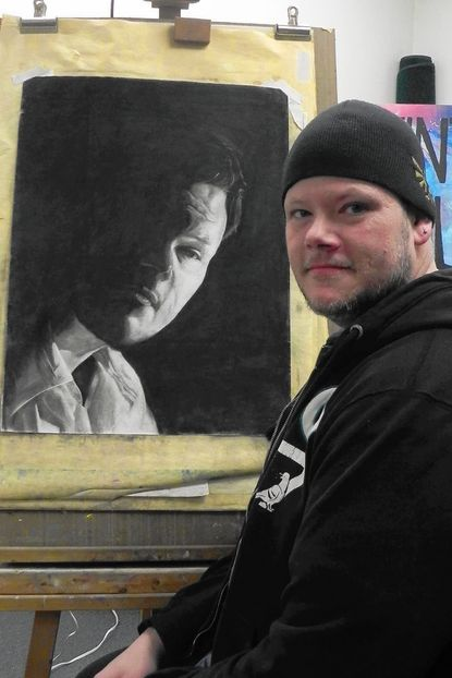 "Dave Hammond is pictured beside a self-portrait of charcoal on paper. An exhibit of his works, titled ""Dave in Color,"" will be on display at Vintage Colors Art Studio, in Taneytown, the weekend of March 18._- Original Credit: Submitted photo"