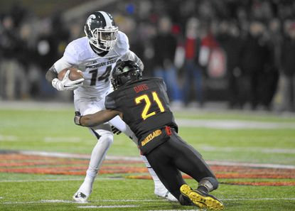 Michigan State wide receiver Tony Lippett (14) carries the ball against Maryland defensive back Sean Davis (21) during the first half of an NCAA college football game, Saturday, Nov. 15, 2014, in College Park, Md. (AP Photo/Nick Wass) - Original Credit: AP