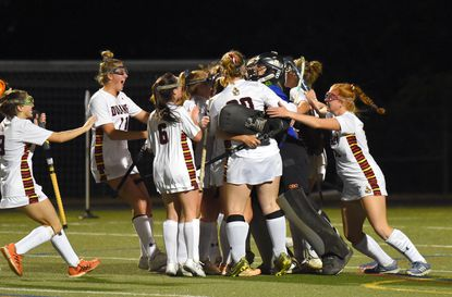 Dulaney celebrates their 2-0 victory over Quince Orchard in Class 4A state field hockey semifinals at Broadneck High School.