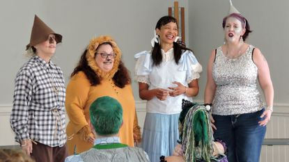 """Chesapeake Harmony Chorus' concert """"Trick or Treat I"""" featured the quartet Dorothy and the Pips. Mimicking Wizard of Oz characters were Peggy Coulter (left to right), Kammy Curry, Reggie Cox and Debbie Bright. They sang 'Somewhere Over The Rainbow.'"""