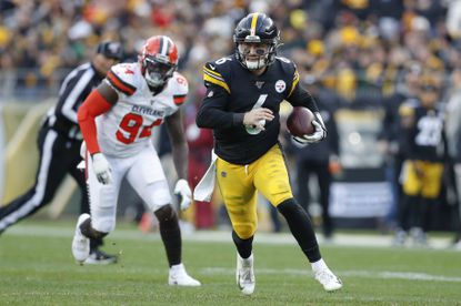 Steelers quarterback Devlin Hodges scrambles past Browns defensive end Bryan Cox in the second half Sunday, Dec. 1, 2019, in Pittsburgh.