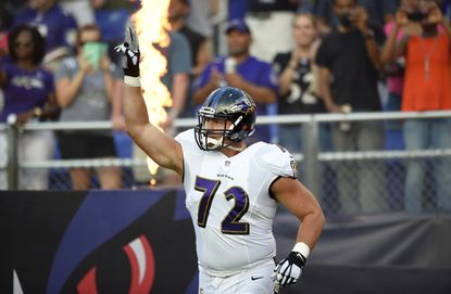 Ravens offensive tackle Alex Lewis gestures as he is introduced before a preseason NFL football game against the Detroit Lions, Saturday, Aug. 27, 2016, in Baltimore.