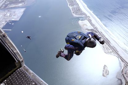 Members of the U.S. Navy parachute demonstration team, the Leap Frogs, perform during a training jump above Naval Amphibious Base Coronado in California. The team is stationed in Coronado and performs demonstrations across the country.