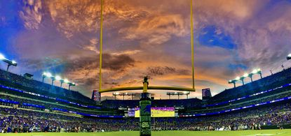 The clouds catch colors of a sunset as the Baltimore Ravens host the New Orleans Saints with fans in the seating bowl in the first preseason game of the 2021 season Sat., Aug. 14, 2021.