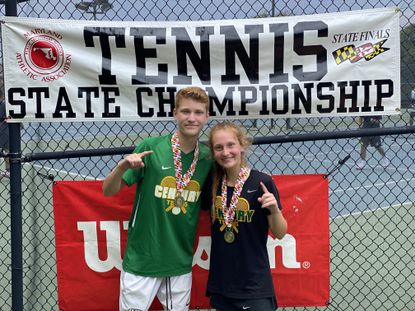 Century siblings Evan and Danielle DeLawter pose for a photo together after winning the 2A mixed doubles state championship at the Wilde Lake tennis club on Saturday.