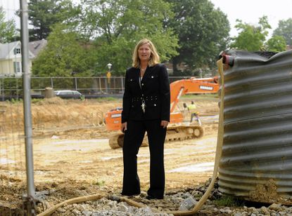 Waverly Elementary/Middle School Principal Michelle Ferris stands in the excavation site for the new, $25 million school that is scheduled to open in mid-to-late 2013.