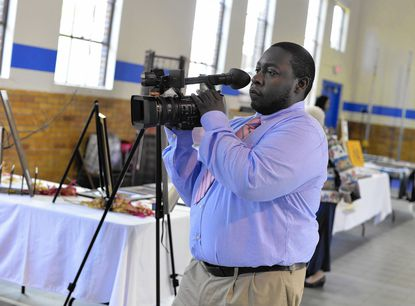 Laurel TV's Edward Thomas, of Bowie, films the Laurel Arts Festival at the Laurel Armory Oct. 12.