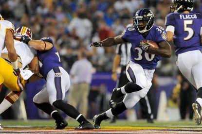 Ravens running back Bernard Pierce runs the ball against the Washington Redskins on Saturday.