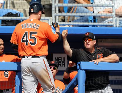 Mark Trumbo of the Orioles celebrates with teammates after hitting a home run in the fourth inning against the Toronto Blue Jays at Florida Auto Exchange Stadium on March 4, 2016 in Dunedin, Fla.