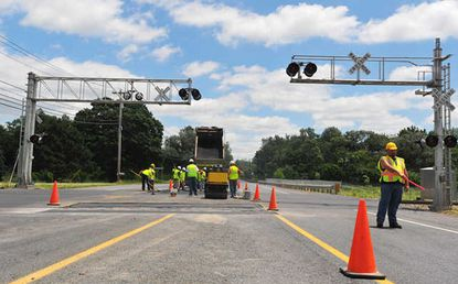 Construction workers work on the Rail crossing on Route 100, just south of Spring Creek Road, Upper Macungie.