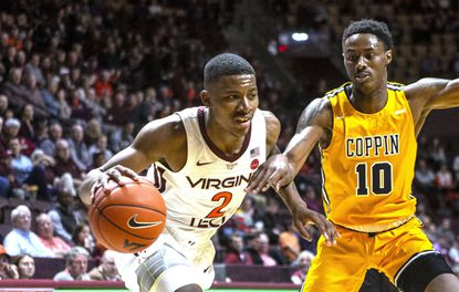 Virginia Tech's Landers Nolley II, drives past Coppin State's Koby Thomas during the first half of an NCAA college basketball game Friday, Nov. 8, 2019, in Blacksburg, Va.