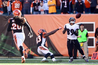 Ravens receiver Steve Smith hauls in a pass while Bengals safety George Iloka falls to the ground late in Sunday's game.