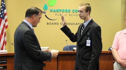 Dr. Sean Bulson, left, Superintendent of Harford County Public Schools, swears in Joshua Oltarzewski, student board representive, who may soon get to vote.