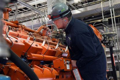 Shane Willis, plant operator at the Eastern Sanitary Landfill Renewable Energy Plant, does routine maintenance on one of the plant's Waukesha engine generators. In a partnership with Energy Power Partners, the plant collects methane gas from decomposing trash in the landfill and converts it to renewable energy. The energy produced supplies 24% of Baltimore county managed facilities' electrical power usage. August 19, 2020