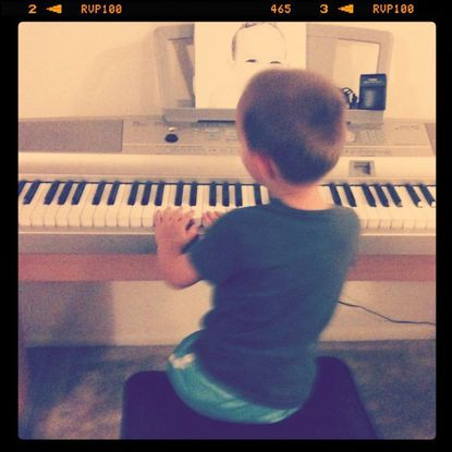Isaac plays a song -- probably not by Rick Astley -- on the keyboard.