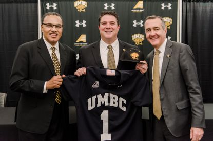 Brian Barrio, center, was introduced as UMBC's new athletic director by UMBC President Dr. Freeman Hrabowski, left, and UMBC Vice President for Institutional Advancement Greg Simmons.