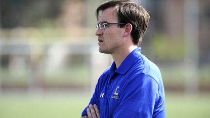 Loyola Blakefield coach Ben Rubeor watches his team from the sideline during a game last season.