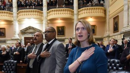 Del. Curtis Anderson, left, wanted to pass on his leadership role as chairman of the Baltimore House delegation. But his colleagues, including Del. Frank Conaway Jr. and Del. Brooke Lierman, voted Friday to keep him in the position for now.