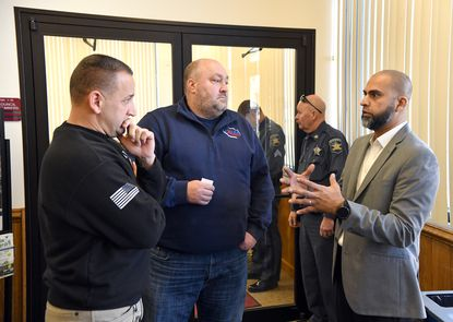Sean Moran, left, and Bruce Huber, center listen as they and Hasan Shah, right, with the Harford Islamic Center, talk about ways they can work together to get the community information about the proposed mosque on Rt. 543 in Bel Air during Wednesday morning's Development Advisory Committee meeting held at the Harford County Council Chambers.