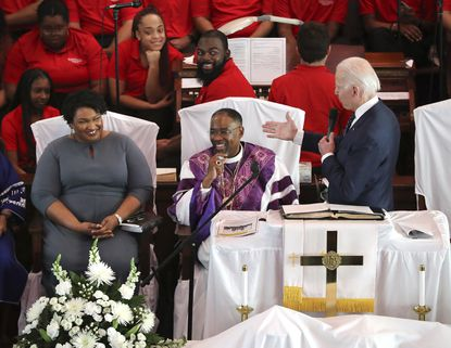 Democratic presidential candidate and former Vice President Joe Biden, right, pays compliments to former Georgia gubernatorial candidate and former state Rep. Stacey Abrams while speaking at Brown Chapel African Methodist Episcopal Church last month in Selma, Alabama. Ms. Abrams has been suggested as a vice president running mate for Biden.