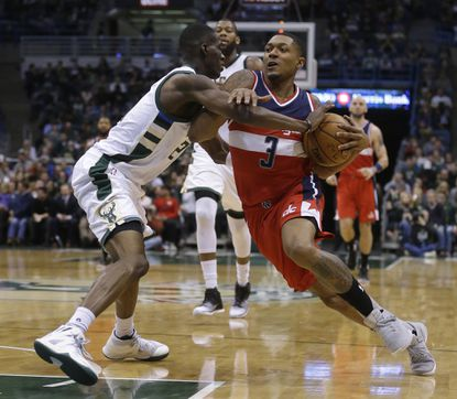 The Wizards' Bradley Beal drives to the basket against the Bucks' Tony Snell during the first half Sunday, Jan. 8, 2017, in Milwaukee.
