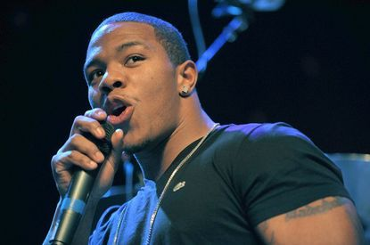 Baltimore Raven Ray Rice sings during the Gridiron Singoff at Rams Head Live