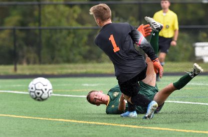 North Harford's Dylan Jablon watches his shot get by Rising Sun goalie Austin Jacob and roll to the goal for a score in the first half of Monday afternoon's game at North Harford.