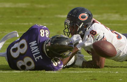 Bears defensive back Adrian Amos collides into Ravens tight end Vince Mayle on an incomplete pass during the fourth quarter Sunday. The Bears beat Baltimore, 27-24.