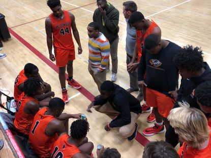The McDonogh boys basketball team huddles during the second half against Friends on Wednesday, Nov. 20.