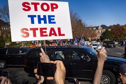 President Donald Trump waves to supporters as he leaves Trump National Golf Club in Sterling, Va., Nov. 7, 2020. Trump's baseless claims of a stolen election resonate on Russian state media, while both Russia and China have painted American democracy as volatile and vulnerable.