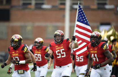 Maryland offensive lineman Ryan Doyle (55) leads the team out during introductions before an NCAA college football game against Bowling Green, Saturday, Sept. 12, 2015, in College Park, Md.