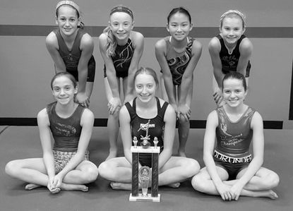 Carroll Gymnastics Level 6 girls squad with its second-place trophy from the Valentine Invitational in Baltimore. Top row, from left: Tara Hornung, Hannah Shipton, Kyra Martindale, Cassie Gilden. Bottom: Ryehn Byrnes, Rachael Herman, Hunter Broman.