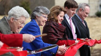 Mary Catherine Bunting, second from left, cuts the ribbon during a ceremony at Maryvale Preparatory School in Towson in March 2012.