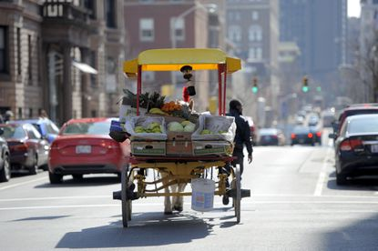 Arabbers Bilal Yusef Abdullah, and his horse, Tony, walk downtown selling fruit and vegetables in 2014.