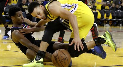 Clippers guard Shai Gilgeous-Alexander disrupts the dribble of Warriors guard Stephen Curry during the second half of Game 2 on Monday.