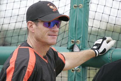 The Orioles' Jeff Conine talks with teammates while standing near the batting cage during practice before a spring training game against the Florida Marlins in Fort Lauderdale, Fla., Monday, March 26, 2006.