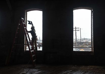 Construction workers earlier this year at the former site of the The A. Hoen & Co Lithograph building in East Baltimore, which has been rehabbed as the new headquarters for the nonprofit Strong City Baltimore.