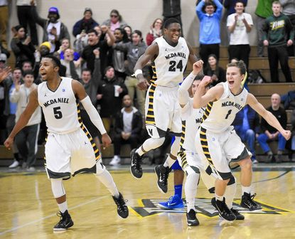 McDaniel's, from left, Cameron Royster, Tim Stewart, Nic Martin, and Wes Brooks celebrate as time expires in the Green Terror's 59-58 win over Franklin and Marshall Saturday, Jan. 17 in Westminster.