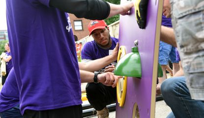 Ravens cornerback Marlon Humphrey spends a day off with other volunteers building a playground at Douglass Homes last year.