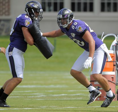 Tight end Phillip Supernaw working with Dennis Pitta during training camp.