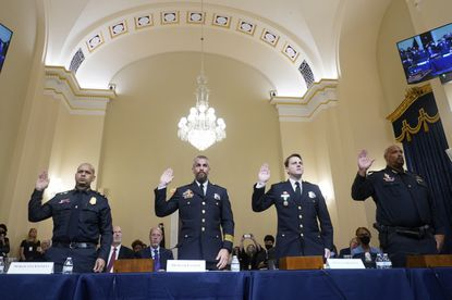 U.S. Capitol Police Sgt. Aquilino Gonell, from left, Washington Metropolitan Police Department officer Michael Fanone, Washington Metropolitan Police Department officer Daniel Hodges and U.S. Capitol Police Sgt. Harry Dunn are sworn in to testify to the House select committee hearing on the Jan. 6 attack on Capitol Hill in Washington, Tuesday, July 27, 2021.